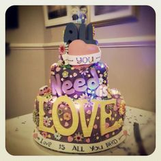 Beautiful and unique Beatles themed  All you need is love wedding cake cake