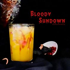 "Cocktail ""Bloody Sundown"" with Mango, Ananas & Rum and a selfmade syrup of Pomegranate."