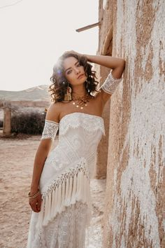 hippie wedding dress 452893306276755043 - RUE DE SEINE'S NEWEST COLLECTION Straight across Strapless lace fitted gown with oversized tassels from the high to low hip. Lace Arm Bands and Full Train. Bohemian Bride, Bohemian Wedding Dresses, Wedding Dress Styles, Dream Wedding Dresses, Bridal Dresses, Wedding Gowns, Bridesmaid Dresses, Bohemian Weddings, Wedding Blog