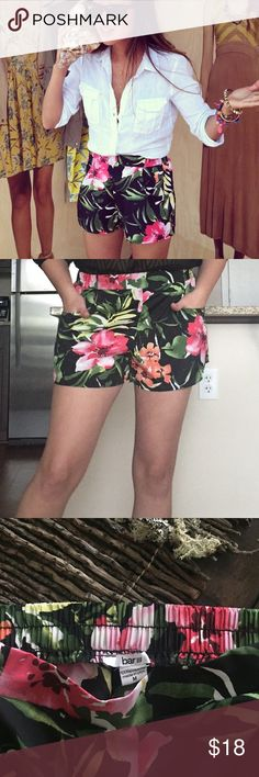 Bar III hawaiian floral flounce pocket shorts! Aloha! As seen on Aimee of Song of Style. The lovely black floral print will look wonderful with neutral colors as well as brights like orange and pink! These shorts will look lovely with a white top and heels, or a great pair of sandals and a light sweater! Elastic waistband. Pockets on sides. Polyester. Perfect condition! Bar III Shorts