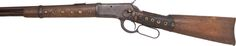 Winchester Model 1892 Lever Action Saddle Ring Carbine With Indian Tacks. NVSN, .38 W.C.F. caliber, 20-inch round barrel with standard sights. Stock wrist covered in leather which has been adorned with brass tacks. The fore-end has been similarly decorated in the Indian style.