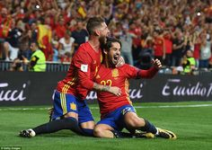 Isco celebrates with Sergio Ramos after scoring the opener, as Spain moved three points clear of Italy in the group standings