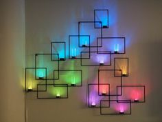 LED lights and glass votives create this geometric neon wall art. Wall Sconces with Hidden Weather Display and Tangible User Interface Deco Luminaire, Luminaire Design, Led Wall Sconce, Wall Sconces, Led Wall Lamp, Led Wall Lights, Candle Sconces, Tea Lights, Weather Display