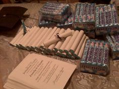 Graduation favors: Thank you notes rolled up around mentos candy.