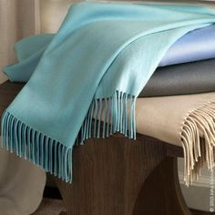 Greta Throw is woven in Italy from a unique combination of wool, silk, and cashmere. This two-tone fringe throw features a pale color on one side and a darker, more saturated version of the same shade on the other. 4 colors.