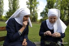 REUTERS via Instagram :  California weed nun Christine Meeusen 57  and India Delgado who goes by the name Sister Eevee smoke a joint at Sisters of the Valley near Merced California U.S. April 18 2017. The Sisters of the Valley Californias self-ordained weed nuns are on a mission to heal and empower women with their cannabis products. Based near the town of Merced in the Central Valley which produces over half of the fruit vegetables and nuts grown in the United States the Sisters of the…