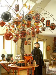 Scott Smith - A towering tree adorned with paper lanterns and other decorations makes an impressive focal point in a dining or breakfast room.