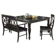 Gather friends for Sunday brunch or an impromptu weeknight dinner around this rustic dining table, showcasing a distressed black rubbed finish and turned leg...