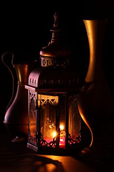 imagine a similar image with a  scene photoshopped inside the windows of the lantern as if the candle were a fireplace.