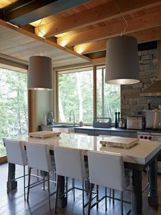 Daylight . Wood Ceiling . Dining and fire . Open to Living Room | Altius Architecture