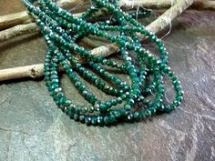 Crystal Rhondelle, 2x3mm, Emerald Green Luster, Tiaria Crystal, 100 pieces per Strand, 7-8 Inch Strand, Priced per Strand by DragonflyBeadsStudio on Etsy