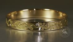 Handmade yellow gold bangle with butterflies, geckos, gum leaves and dragonflies and set with diamonds John Miller, Handcrafted Jewelry, Handmade, Engraved Jewelry, Geckos, Gold Bangles, Dragonflies, Butterflies, Artisan