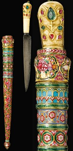 """Indian kard, 19th century, watered-steel blade with chiselled palmette on the straight edge near the forte with a gold overlay inscriptive cartouche, the gilt steel hilt with marine ivory facings, inlaid in the kundan technique with green and pink gemstones, the scabbard with polychrome enamel decoration featuring floral bouquets within lobed cartouches, with bands of floral scrolls and bud finial, inscribed:""""Sarkar Mir Shir Muhammad Ibn Mir Fath Khan Talpur"""" """"The Lion of Sindh""""."""