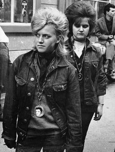 The Rockers were another teenage subculture of the '60s, who rivaled the Mods. Rockers preferred to be more scruffy and rebellious. Their fashions included black jeans, leather jackets, heavy biker boots, and accessorized with studs and chains. Rockers often greased their hair into a quiff. The fashion was heavily influenced by bygone decades, namely the '50s and it's rock 'n' roll and style, with rocker poster boys including Gene Vincent and Marlon Brando.