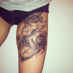 """If you never get lost, then you never get found"" thigh tattoo with realistic roses and compass. Lovely work."