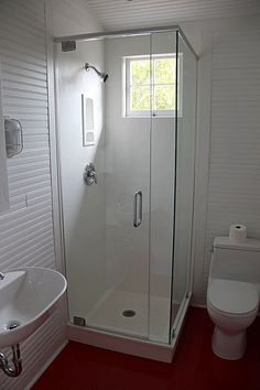 A very nice bathroom - I really like the standing shower. And look at that RED floor!  Love it!