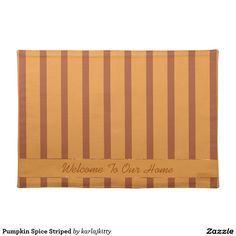"""Pumpkin Spice Striped Cloth Placemat  Pumpkin and rust stripes, a pumpkin ribbon with shiny borders, and a text field. The text shown is """"Welcome To Our Home"""" - but you can replace that with your own, clear it out, or click on the """"Customize it!"""" button for more advanced options, to adjust the font size, type, color, or to add images, etc. Design is on both ."""