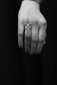 Jean Philippe Burton - finger tattoos