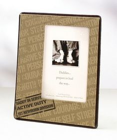 "This picture frame is a perfect way for daddy to display his favorite photo of baby. It holds one 4"" x 6"" photo. The entire frame measures 6.75"" x 8.375"" and includes an easel on the felt back. The canvas front is decorated on the bottom left corner with a logo that reads ""DADDY IN SERVICE, ACTIVE DUTY, 1ST NEWBORN DIVISION. Background words include courage, strength, service above self, perseverance, integrity and dedication.    #timelesstreasure"