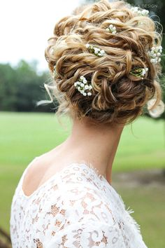 Naturally curly updo for wedding