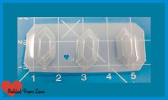 This is a Durable plastic that is made for Resin Casting. Pieces pop out easily-May have a few water marks, but a thin coat of resin or resin spray will take care of that. This Mold Features 3 faceted Rupee Shapes Perfect size for a pendant, bow center, chocolates, You name it! Do