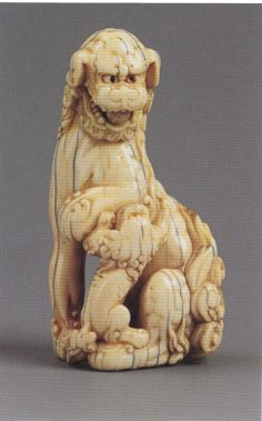 Antique Ivory netsuke of a Shishi & pup