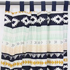 """Complete the look of your Aztec Gold nursery with our Aztec Gold and Mint Curtains . They are perfect for any nursery or big kid design. Measures 42x84"""", sold i"""