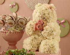 Ursa com flores