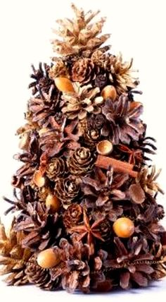 Scented Pine Cone Christmas Tree - Unfortunately, the website for this was taken down but here's the basic concept. It incorporates acorns, pine cones, cinnamon sticks, star anise, and whole cloves ... A cone made out of floral foam is used as the base. The natural aromatics are added using floral wire and pins. Use essential oils to freshen when scent fades. ❊