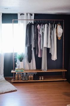 DIY Garment Rack for Your Wardrobe Rolling DIY Garment Rack. Get the full simple and easy tutorial to make your own wardrobe rack! Get the full simple and easy tutorial to make your own wardrobe rack! Hanging Racks, Diy Hanging, Diy Clothes Hanging, Hanging Closet, Diy Wardrobe, Wardrobe Rack, Wardrobe Storage, Black Wardrobe, Wardrobe Design