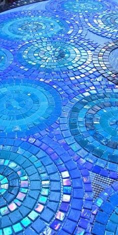 tiles for both bathrooms but in green and brown & blue and silver