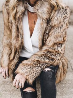 Faux fur + distressed denim.