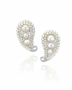 A rare pair of natural pearls, pearls and diamond brooches, by G. Estimate HK$950,000 – HK$1,200,000 (US$120,000-150,000).