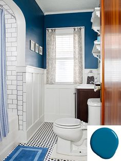 "Formerly Pepto-Bismol pink, this bath with Benjamin Moore's Blue Danube walls has a new beadboard ceiling, faux board-and-batten wainscot, and open shelves, all painted with a white ""hiding and leveling"" latex."