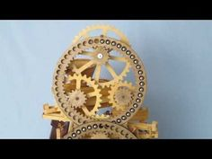"""From the youtube account of Ronald Walters, an annotated video of a """"marble machine"""" in the style of Rube Goldberg:    This is intended to be an awkward, overly complicated mechanism for the sole purpose of entertainment and to make noise in the process. People seem to enjoy watching gears turn and marbles running around in circles making noise.    There are 16 gears hand-cut from ½"""" Baltic Birch plywood driven by an electric gear reduction motor.    -- I want one!"""