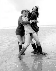 Laughing friends on the beach