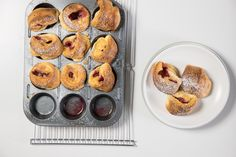 We miniaturized the iconic poufy pancake by baking it in muffin cups instead of a big frying pan. Then we added raspberries that get warm and jammy in the oven. As with bigger dutch babies, the secret to getting a good puff is to preheat the pan with the butter before you add the batter. And be sure everyone is sitting down when you take the babies from the oven—they deflate quickly, though still taste delicious.
