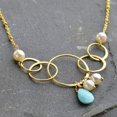 Our gold plated sterling silver five circle link is a gorgeous handmade piece composed of five graduated circles from small to large. A bold style without the weight! This link lends itself to effortless necklaces and bracelets.