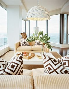 Clearwater realtors help real estate search buyers buying second homes or primary homes in international real estate gulf coast of Florida, Pinellas county beach home decor. Woven decor, round textured lamps & ceiling-high palm leaves creates fun & energizing room