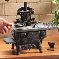 cast iron miniature stove I had this same one, my grandma gave it to me back in the 60's to play with my barbie's