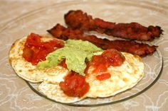 Ingredients:    2 eggs    2 strips of bacon    tbs guacamole    tbs salsa