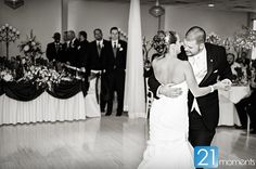 The bride and groom share their first dance at the Atrium.