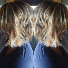 Cute short hairstyle. Golden and platinum blonde balayage highlights