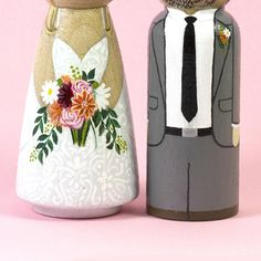 Now that is how you complete a cake! These wooden personalized bride and groom wedding cake toppers are made to look just like the two of you on your special day. From the details in your dress and the flowers you carry, to the way he parts his hair—every little nuance will come