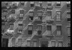 New York, New York. 61st Street between 1st and 3rd Avenues. House fronts. Photograph by Walker Evans. The photographs in the Farm Security Administration - Office of War Information Photograph Collection form an extensive pictorial record of American life between 1935 and 1944. This Is America! Foundation is creating a pictorial record of America today. Image from the Library of Congress. #newyorkcity #windows #blackandwhite #photography #shadow #america