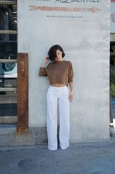 Karla Deras is wearing wide leg white trousers and camel cropped sweater. From Karla's Closet