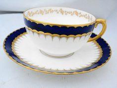 Antique Coalport china cobalt blue band gold gilt tea cup and saucer