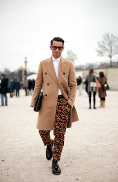 Are These The World's Best Dressed Men? #refinery29  http://www.refinery29.com/mens-fashion-week/street-style#slide-35  Simone Marchetti pares down the flower-power with a classic camel coat. Photographed by Christian Vierig...