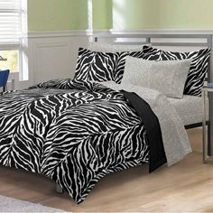 This ultra-soft microfiber comforter set features a stylized Zebra print in black and white. The comforter and sham reverse to a solid black. The coordinating sheets feature a tonal white zebra print. Comforter Sets, Duvet, Black White Bedding, Zebra Print Bedding, Preteen Bedroom, Teen Bedding, Bed In A Bag, White Zebra, Home Bedroom
