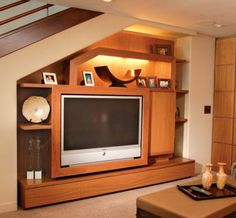 Tv and storage could work under stairs house stuff for Tv showcase designs under staircase